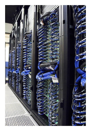 The image shows supercomputer clusters with blue wires.